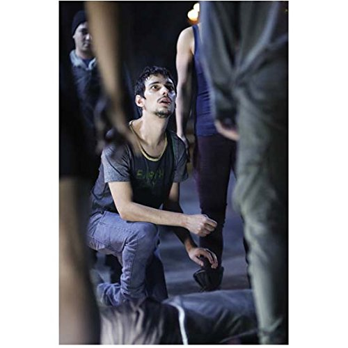 Devin Bostick 8 Inch x 10 Inch PHOTOGRAPH The 100 (TV Series 2014 - ) Kneeling Looking Up kn